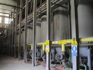 Olive oil extraction plant with dryers, roaster, solvent extractor and steam generator.