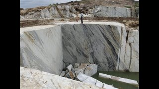 Business seeks funds to begin excavation of granite from a mine of 11 acres.