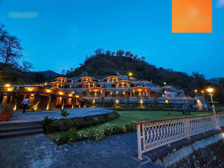 Residential international yoga school and resort with 20 cottages in Rishikesh, Uttarakhand.