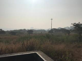 A commercial plot of 2 acres on the hilltop area in Pune, surrounded by forest.