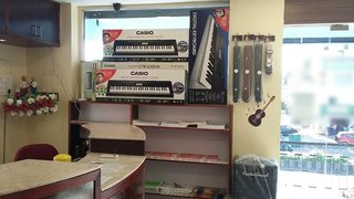 Musical instrumental retail store that imports and sells quality musical instruments, books and gift items.