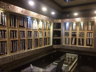 Gold and silver jewelry retailer with 200+ returning customers located in a commercial area.