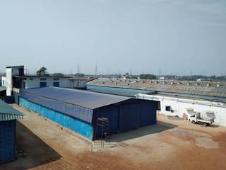 Commercial land of 100,000 Sq Ft with a boundary wall and 7 constructed sheds.