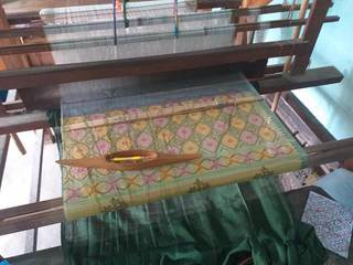 Production unit cum training center for manufacturing traditional handloom for men and women.