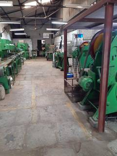 Asset Sale: 22 metal tin container manufacturing machines in perfect working condition.