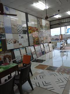 Business in Bhiwandi selling ceramic tiles, cement and building materials through a showroom.