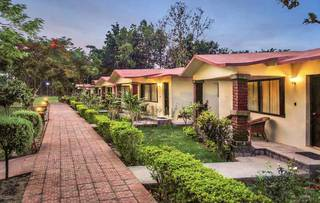Operational safari resort located in Corbett National Park along the main park road.
