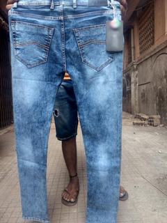 Jeans manufacturer having tie ups with wholesalers in multiple cities.