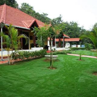 For Sale: Homestay in a picturesque location in Karnataka with 5 independent rooms.